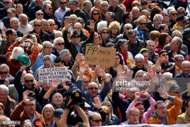 Demonstrators seen displaying placards during the demonstration Ten of thousands of pensioners took to the street of Barcelona during a protest...