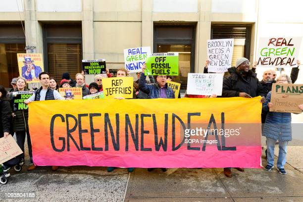 Demonstrators seen holding a huge banner saying green new deal during the protest 350org Food Water Watch and other groups organized a protest to...