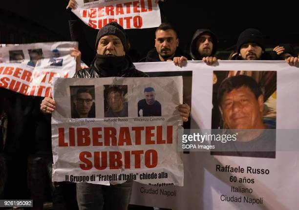 Demonstrators seen holding banners with the photo of the kidnapped men printed on Rally organized by the family of the three Neapolitan men kidnapped...