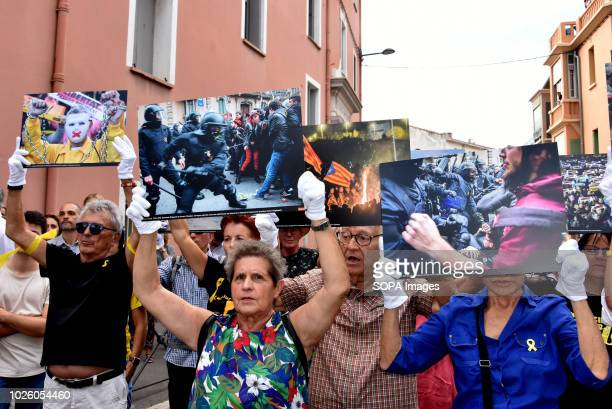 Demonstrators seen holding photographs of the Catalonia Proindependence movement during a protest to call for the release of the political prisoners...