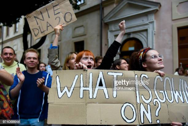 Demonstrators seen holding placard and banners during the demonstration Students from the department of Philosophy of Jagiellonian University take...
