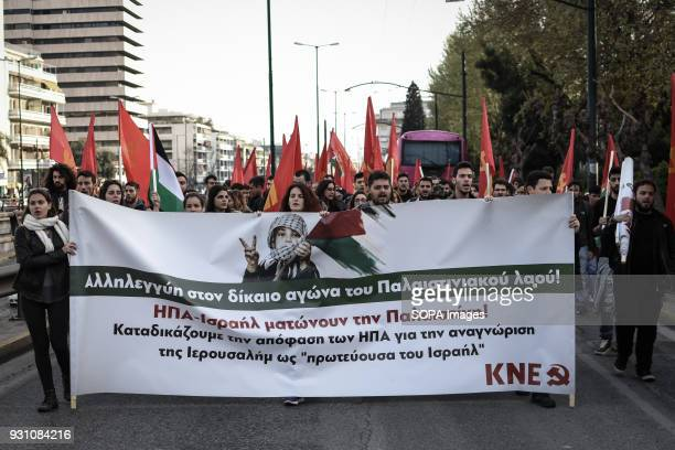 Demonstrators seen holding several palestinian flags and a large banner march toward the Palestinian embassy in Athens during a protest to demand the...