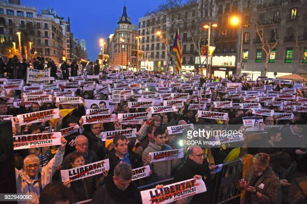 Demonstrators seen holding several placards writting on it 'freedom political prisoners' during a protest Hundreds of people have taken to the...