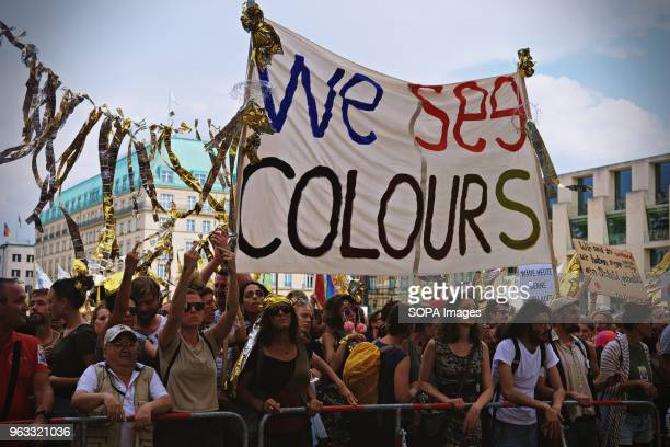 Demonstrators seen shouting slogans during the protest Techno lovers and anti racism activists have marched in Berlin against a rally organised by...