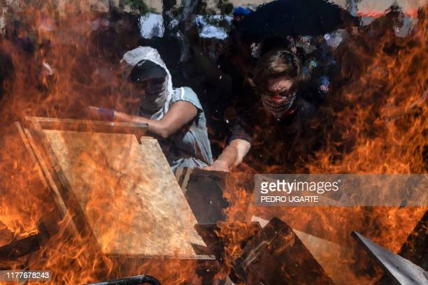 Demonstrators set a barricade near Plaza Italia in Santiago, on the fifth straight day of street violence which erupted over a now suspended hike in...