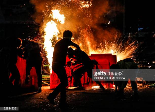 Demonstrators set a barricade on fire during a protest against police brutality in Cucuta, on the Colombian border with Venezuela, on September 10,...