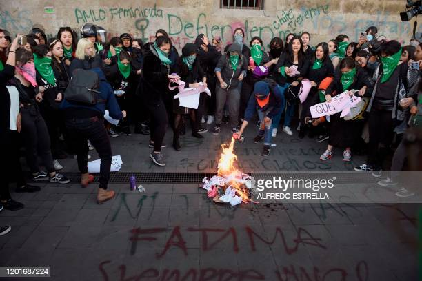 Demonstrators set a fire as they gather outside the National Palace, in Mexico City, on February 18 to protest gender violence. - Dozens of women...