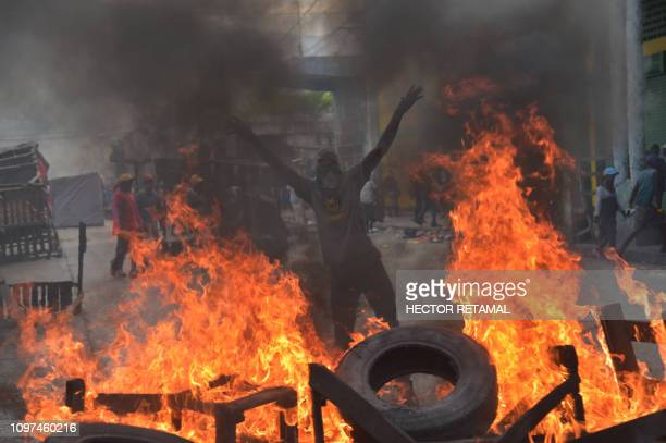 Demonstrators set alight tires on the fourth day of protests in PortauPrince on February 10 2019 Demonstrators are demanding the resignation of...
