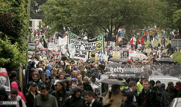 Demonstrators set off to march to the security gate at the G8 summit on July 6, 2005 near Gleneagles. The G8 summit where delegations from UK, US,...