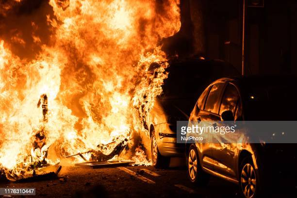 Demonstrators set on fire a barricade in a clash with police on October 16 2019 in Barcelona Spain