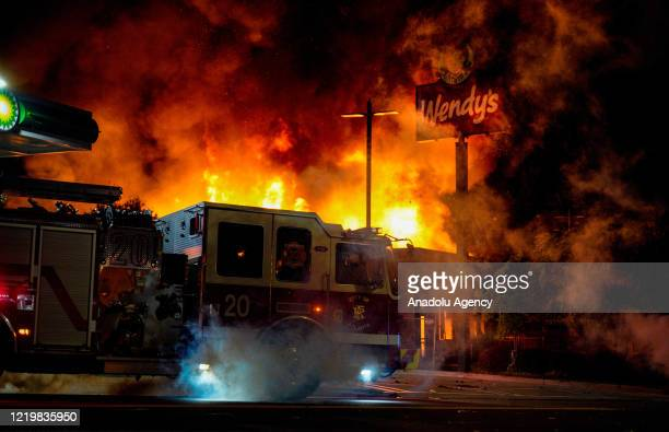 Demonstrators set on fire a restaurant during the protest after an Atlanta police officer shot and killed Rayshard Brooks at a Wendy's fast food...