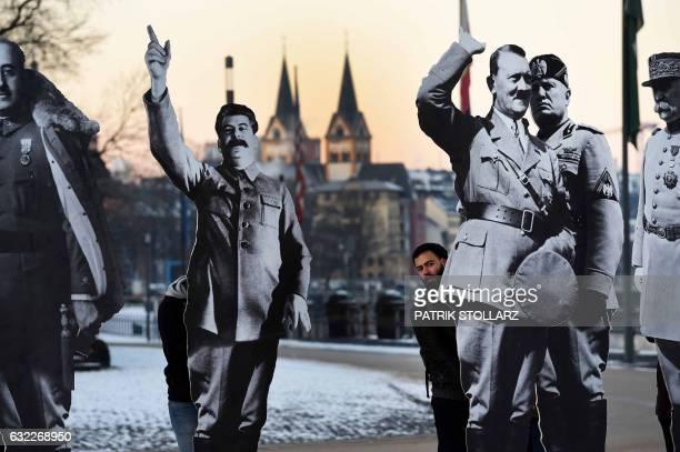 Demonstrators set up cardboard cutouts depicting Spanish dictator Francisco Franco Soviet dictator Joseph Stalin German dictator Adolf Hitler Italian...
