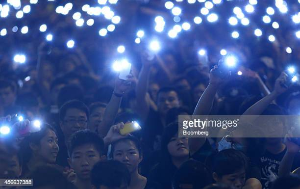 Demonstrators shine lights from their mobile devices during a protest outside the Central Government Offices in Hong Kong China on Saturday Oct 4...