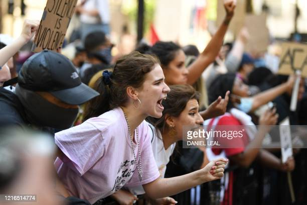 Demonstrators shout as they join others outside Downing Street in central London on May 31, 2020 to protest the death of George Floyd, an unarmed...
