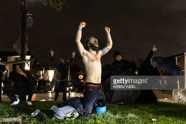 "Demonstrators shout ""Don't shoot"" at the police after curfew as they protest the death of Daunte Wright who was shot and killed by a police officer..."