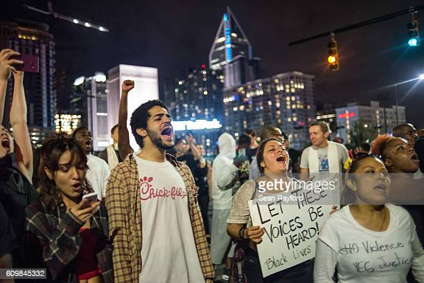 Demonstrators shout during protests September 22 2016 in Charlotte North Carolina Protests began on Tuesday night following the fatal shooting of...