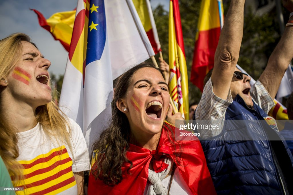 Demonstrators shout in support of Spanish unity during a march on Spain's National Day in Barcelona, Spain, on Thursday, Oct. 12, 2017. Prime Minister Mariano Rajoy gave his Catalan antagonist Carles Puigdemont five days to clarify whether he has declared independence from Spain or not as the country prepared for its national holiday on Thursday. Photographer: Angel Garcia/Bloomberg via Getty Images