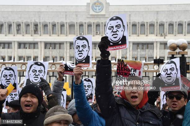 Demonstrators shout slogans and hold placards during an anti-corruption rally in Bishkek on November 25, 2019. - Around 1,000 people on November 25,...
