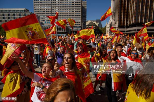 Demonstrators shout slogans and hold Spanish flags as they protest against the independence of Catalonia under the slogan 'For the defense and unity...