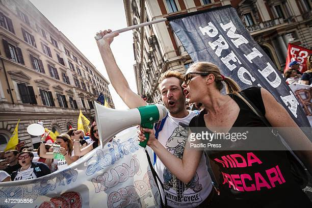 Demonstrators shout slogans and wave flags during a nationwide day of strike in Rome to protest against Prime Minister Matteo Renzi's 'the Good...