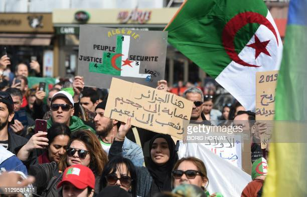 Demonstrators shout slogans and wave placards during a rally in Marseille southern France on March 10 in support of the ongoing protests in Algeria...