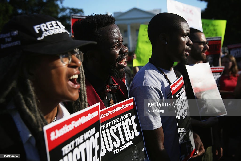 Activists Deliver Petition Calling On Justice Dept Investigation Into Mike Brown Killing : News Photo