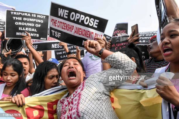 Demonstrators shout slogans as they hold placards to protest against the government's Citizenship Amendment Bill during the shutdown called by North...