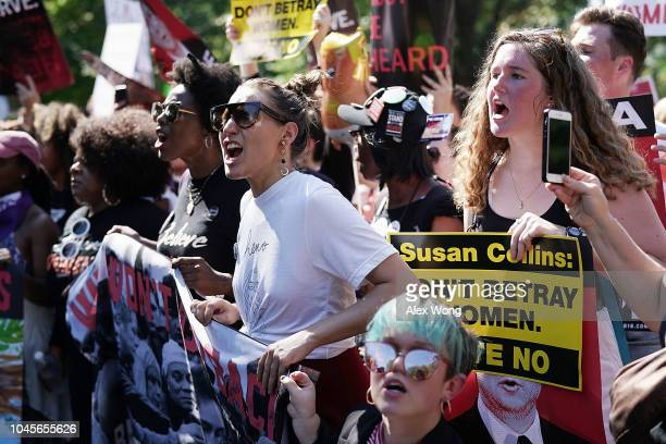 Demonstrators shout slogans as they march towards US Supreme Court for a rally October 4 2018 in Washington DC Activists are holding a rally to...