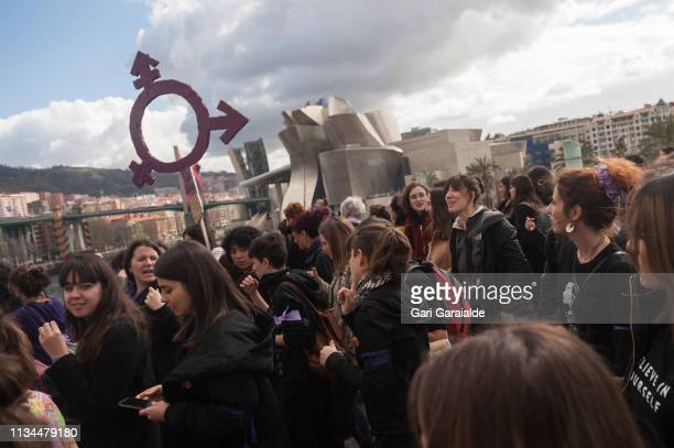 Demonstrators shout slogans as they protest during a one day strike to defend women's rights on International Women's Day on March 08 2019 in Bilbao...