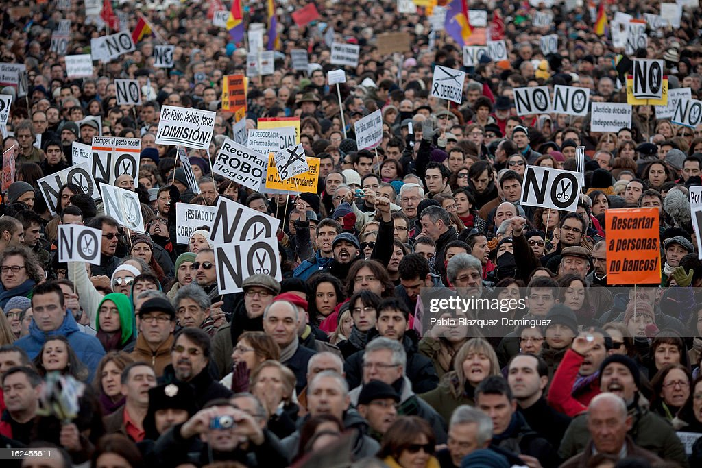 Demonstrators shout slogans at Neptuno Square during a march by thousands of people on February 23, 2013 in Madrid, Spain. Public health workers, civil servants and disaffected citizens converged on central Madrid to protest against the austerity measures of Prime Minister Mariano Rajoy.
