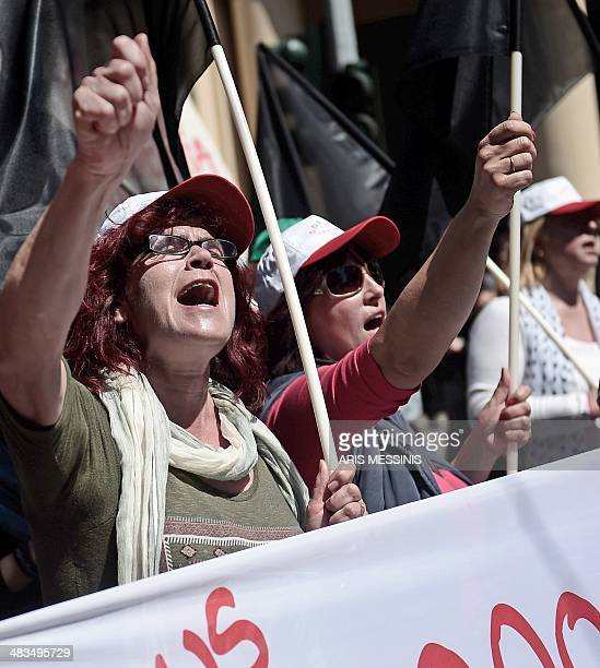 Demonstrators shout slogans during a 24hour general strike in Athens on April 9 2014 Greek unions held a 24hour antiausterity strike today shutting...