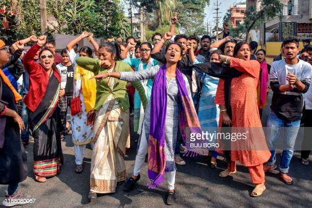 Demonstrators shout slogans during a protest against the government's Citizenship Amendment Bill in Guwahati on December 12, 2019. - Indian police...