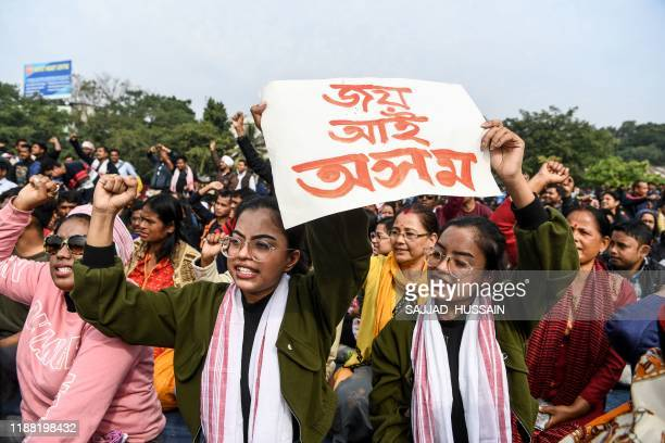Demonstrators shout slogans during a protest against the government's Citizenship Amendment Bill in Guwahati on December 13, 2019. - Internet access...