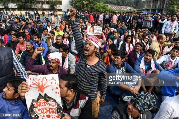TOPSHOT Demonstrators shout slogans during a protest against the government's Citizenship Amendment Bill in Guwahati on December 13 2019 Internet...