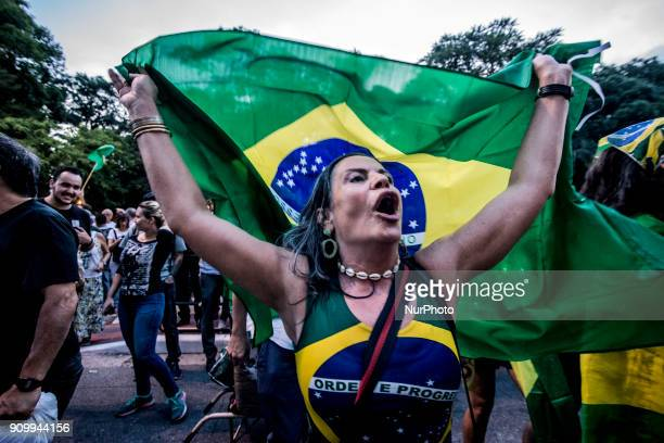 Demonstrators shout slogans during a protest against Luiz Inacio Lula da Silva in Sao Paulo Brazil on Wednesday Jan 24 2018 The first of three judges...
