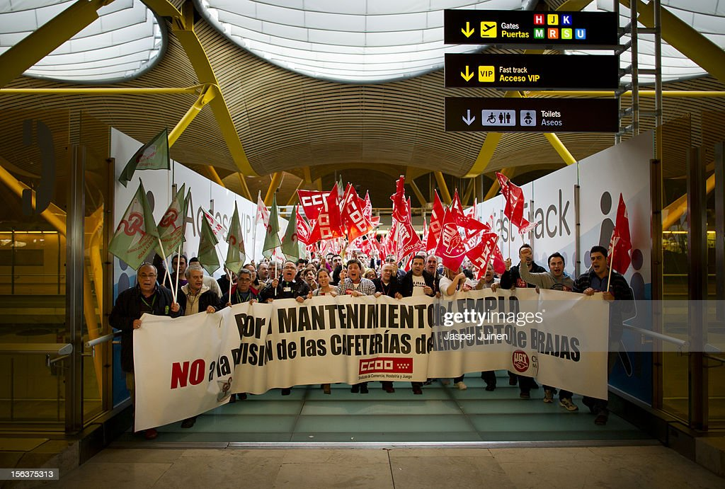 Demonstrators shout slogans, forcing shops to close for business, at Barajas airport on November 14, 2012 in Madrid, Spain. A coordinated general strike by unions in Spain and Portugal has paralysed public transport in the two countries with further strikes planned across Europe. The strike against the governments' austerity measures have force hundreds of flights to be cancelled and factories and ports to come to a standstill.