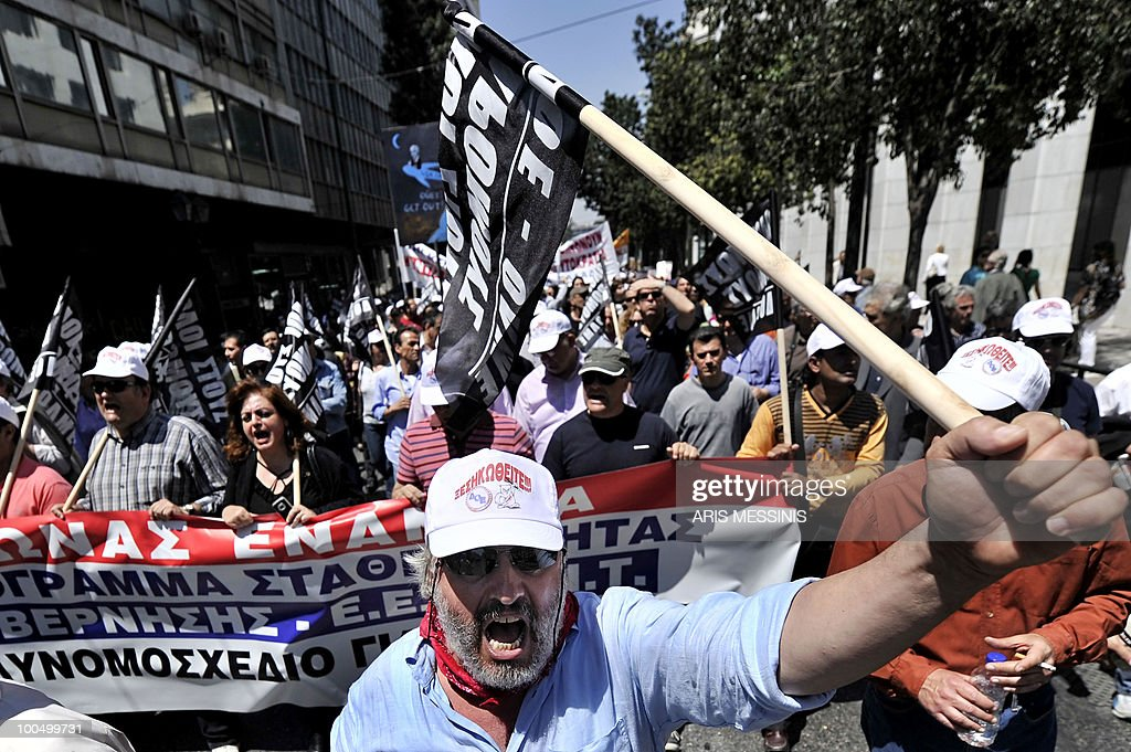 Demonstrators shout slogans near the Parliament building during a protest in Athens on May 4, 2010. Earlier, demonstrators stormed the Athens Acropolis and thousands of civil servants launched a walkout ahead of a general strike against unprecedented austerity spending cuts. With the government demanding painful 'sacrifices' after the country secured a 110 billion euro (145 billion dollar) debt bailout, Labour Minister Andreas Loverdos said: 'We have only one aim, to save Greece, and we are not going to budge.'