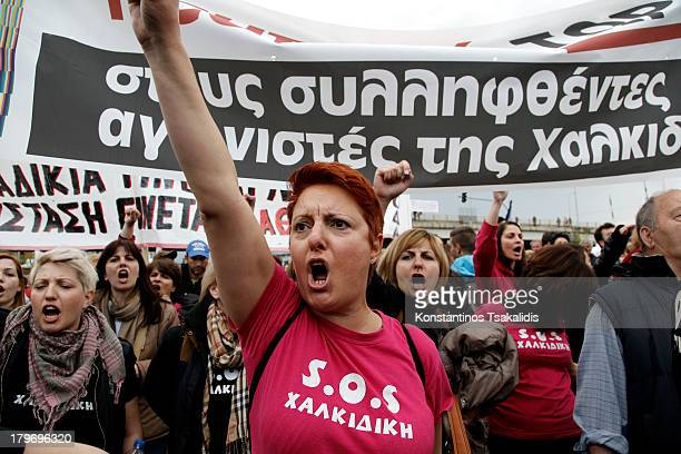 Demonstrators shout slogans outside the Police Headquarters department of Thessaloniki during a protest against the arrest of two residents of...