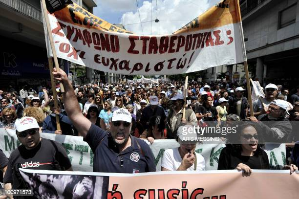 Demonstrators shout slogans prior to a protest march marking the 24hours general strike against the austerity measures in central Athens on May 20...