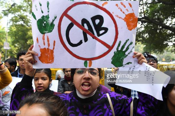Demonstrators shout slogans to protest against the government's Citizenship Amendment Bill in New Delhi on December 10 2019 Protestors in northeast...