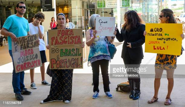 Demonstrators show signs calling Minister of Justice and Public Security of Brazil Sérgio Moro corrupt and fascist during the second day of Estoril...