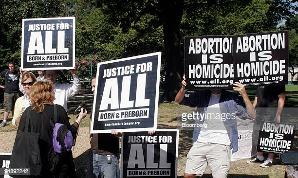 Demonstrators show their support for the appointment of Judge John Roberts to the U.S. Supreme Court, Monday, September 12 in Washington D.C....