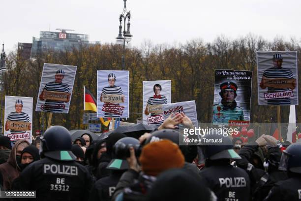 Demonstrators shows placards depicting Karl Lauterbach, SPD, Finance Minister and vice Chancellor, Olaf Scholz , the virologist Christian Drosten and...