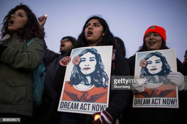 Demonstrators sing and hold signs during a rally supporting the Deferred Action for Childhood Arrivals program or the Dream Act outside the US...