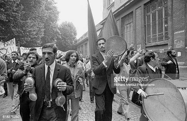 Demonstrators sing and play drums as they march past Clichy city hall After an accident the day before in front of Les Cables de Lyon factory the...