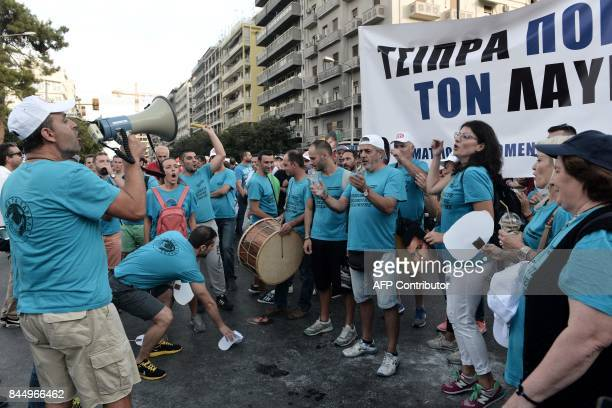Demonstrators sing during a protest against the government's austerity measures and reforms outside the annual Thessaloniki International Fair in...