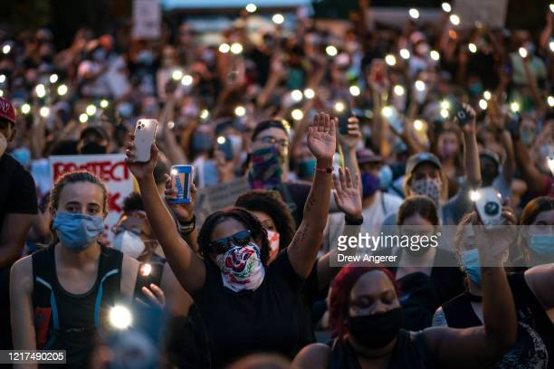 Demonstrators sing Lean On Me near Lafayette Park and the White House on June 3 2020 in Washington DC Protests in cities throughout the country...