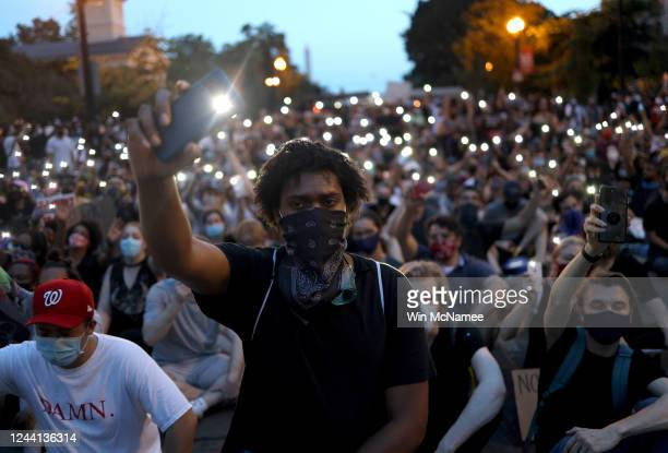 """Demonstrators sing """"Lean On Me"""" near the White House during a peaceful protest against police brutality and the death of George Floyd, on June 3,..."""