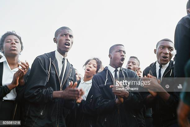 Demonstrators singing during the Freedom March to Washington More than 200000 people participated in the March on Washington demonstrations The...