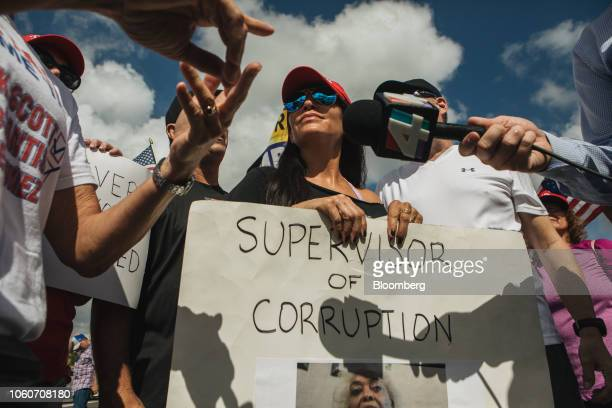 Demonstrators speak to members of the media during a protest outside the Broward County Supervisor of Elections office in Lauderhill Florida US on...